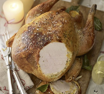 Roast turkey with a slice removed to reveal juicy flesh