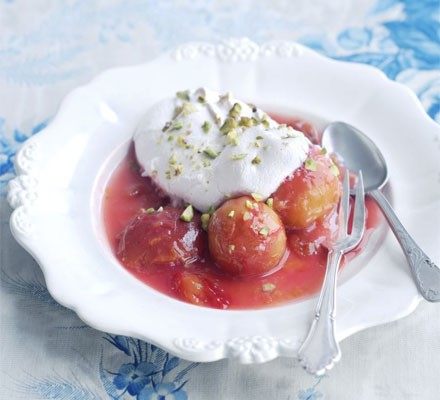 Syrupy plums with pistachio meringues