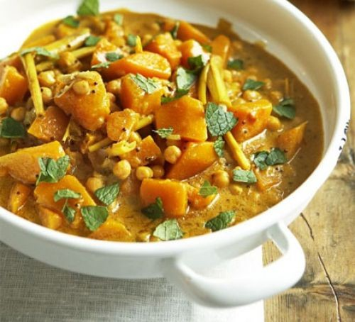 Pumpkin and chickpea curry in a white bowl