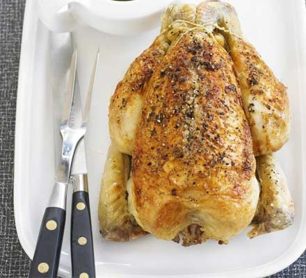 Classic roast chicken & gravy with carving knife & fork