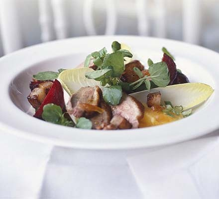 Warm duck salad with walnut & orange dressing