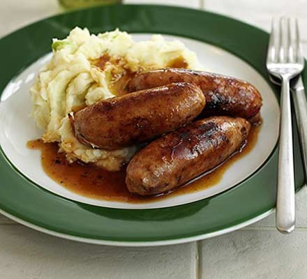Sausages and mash on a plate with sweet chilli sauce