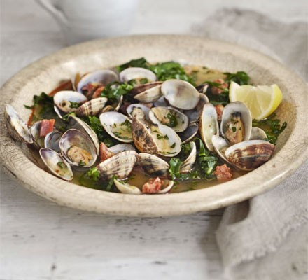 Steamed clams in saffron & spring green broth
