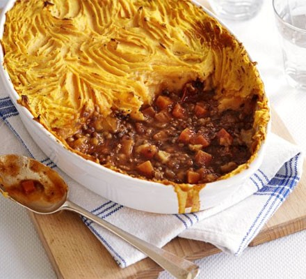 Ultimate shepherd's pie in a dish with a portion gone