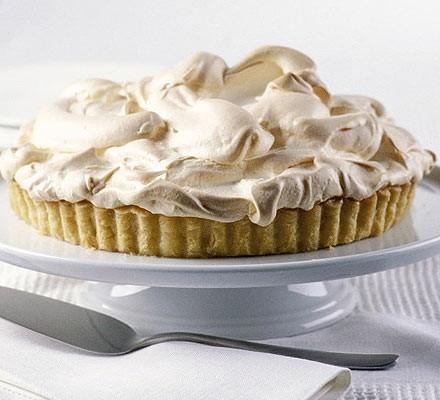 Ultimate lemon meringue pie on a cake stand