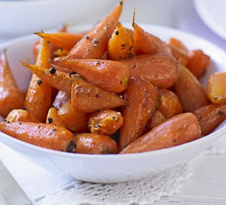 Honey-glazed roast carrots in a bowl