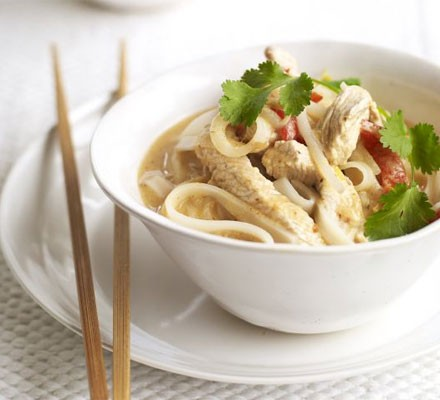 Curried turkey noodle soup in bowl