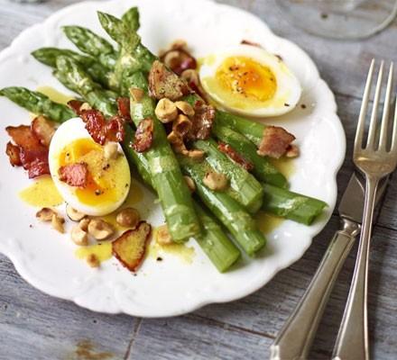 Warm salad of asparagus, bacon, duck egg & hazelnuts