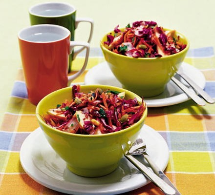 Two bowls of colourful salad