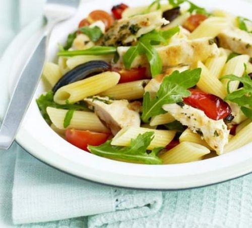 Pasta with veg and chicken on plate