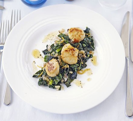Seared scallops with flavoured greens