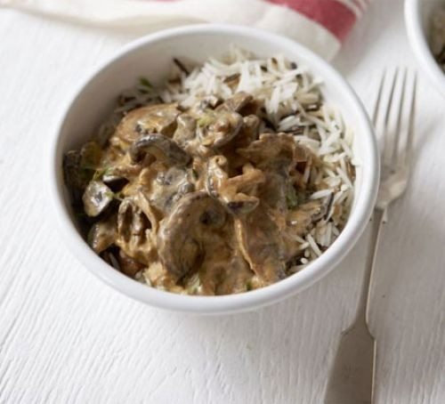 Mushroom stroganoff with rice in a bowl