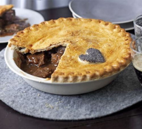 Beer and beef pie with slice taken