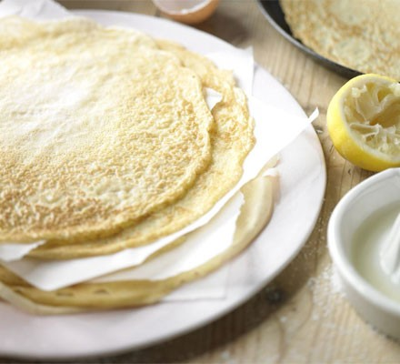 Classic crêpes on a plate with lemon