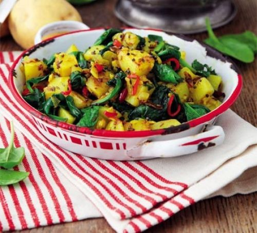 Sag aloo in a serving dish