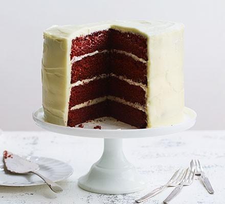 Red velvet cake served on a cake stand