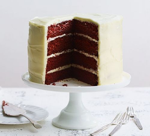 Red velvet cake sliced on stand