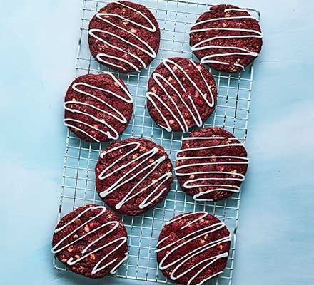 Red velvet cookies served on a wire tray