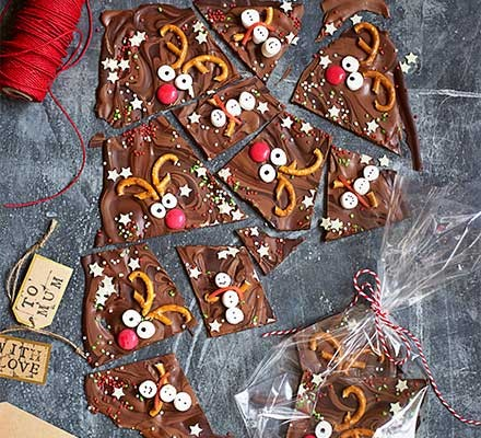Chocolate reindeer & snowman bark cut into pieces with gift tags