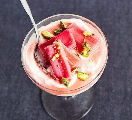 Rhubarb fool with confit rhubarb & pistachios served in a dessert glass