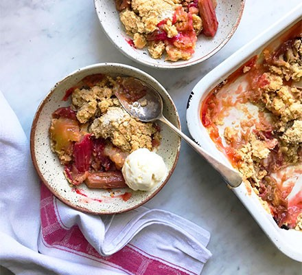 Rhubarb & apple crumble served in bowls with ice cream