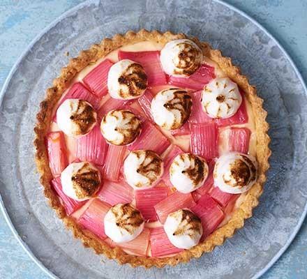 Rhubarb & custard meringue tart served on a plate