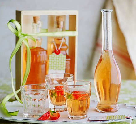 Flavoured rhubarb and strawberry vodka in bottle and glasses