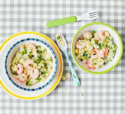 Two bowls containing courgette and pea risotto with prawns