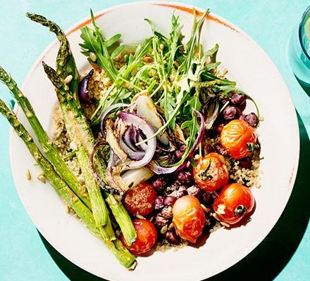 Roast asparagus bowls with tahini lemon dressing served on a plate