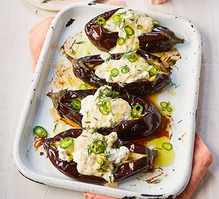 Roast aubergines with almond tarator, feta, dill & green chilli on a rectangular plate