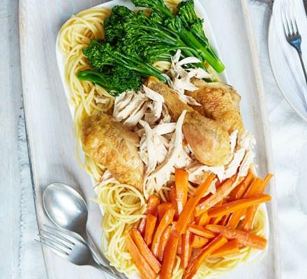Roast chicken, carrots, broccoli and spaghetti on plate