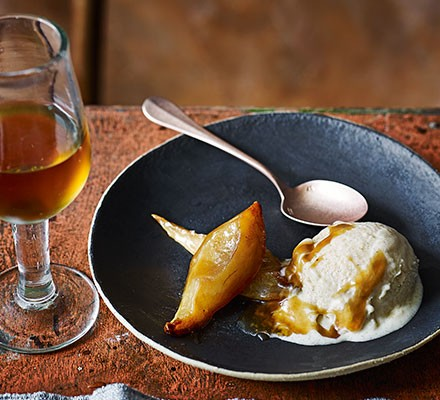 Roast pear & sherry ice cream in a bowl with spoon, served with a glass of sherry