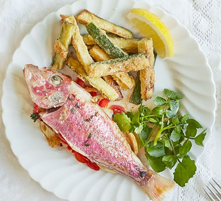Roast red mullet with courgette fries & saffron aïoli served on a white plate
