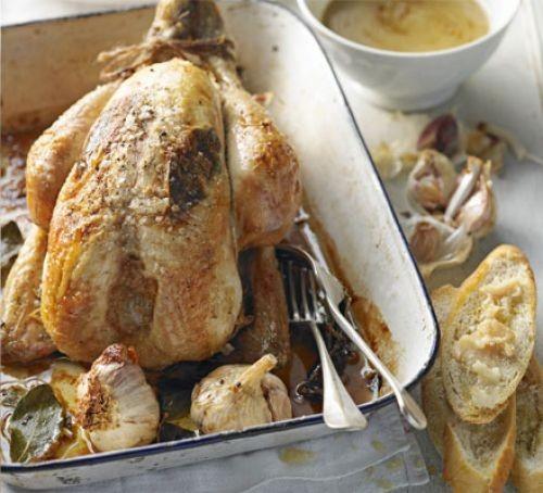 Whole roast chicken with whole garlic, bay & white wine
