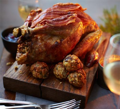 Roast guinea fowl wrapped in pancetta, with chestnut stuffing