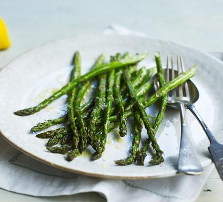 Asparagus on plate with cutlery