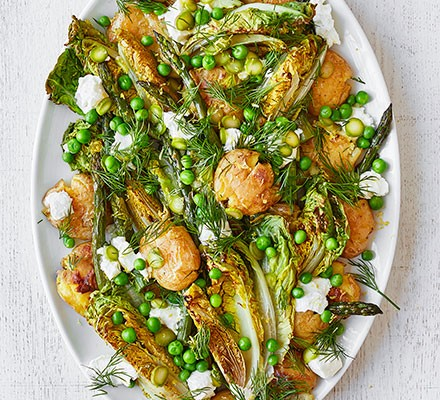 Roasted asparagus & smashed new potato salad served on a plate