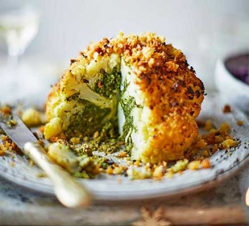 Roasted whole cauliflower on a plate