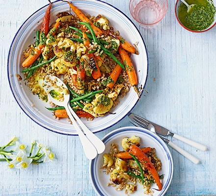 Roasted new carrots, cauliflower, grains & carrot-top dressing served in bowls