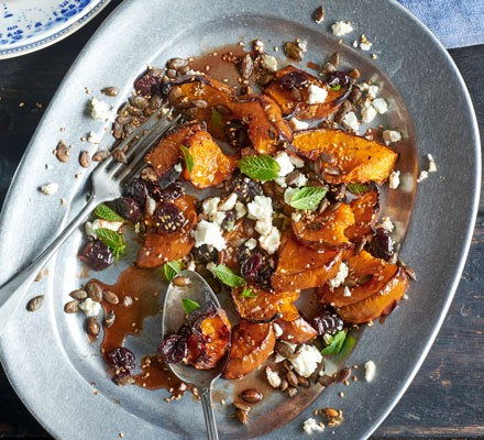 Roasted squash with sour cherries, spiced seeds & feta