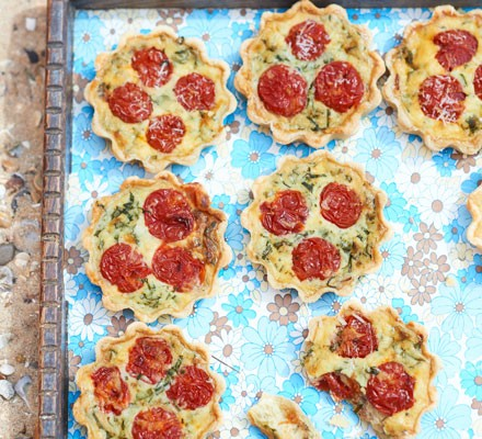 Roasted tomato & pancetta mini quiches on a tray