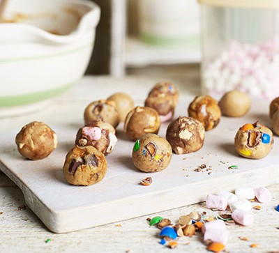 Cookie dough balls on a board