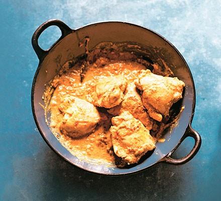 Saffron chicken korma served in a dish