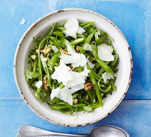 Bowl of green runner beans topped with Parmesan shavings
