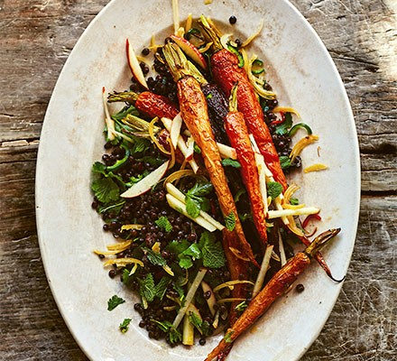 Salad of roast carrots, apple & lentils with chilli & preserved lemons served on a plate