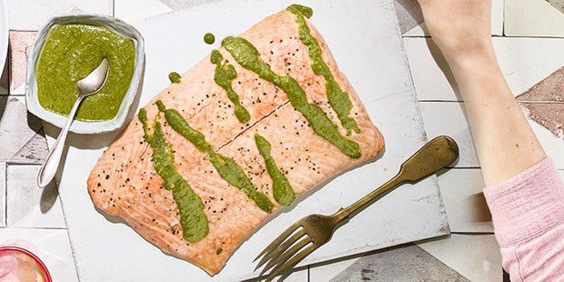 Whole salmon with green sauce