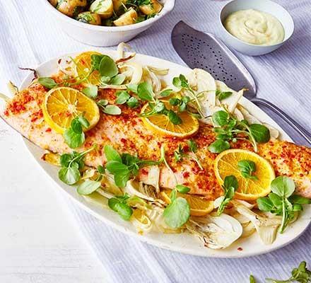 Chilli & orange salmon with watercress new potatoes & wasabi mayo served on a decorative plate