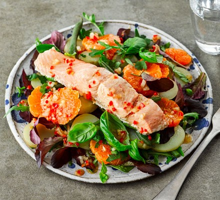 Salad topped with a salmon fillet