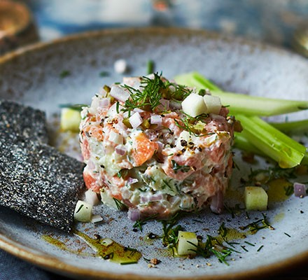 Salmon tartare with apple, dill & gherkins served on a plate