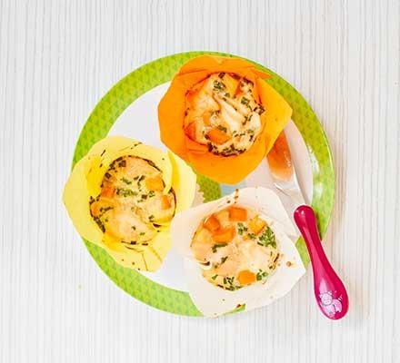 Three salmon & sweet potato muffins on a green plate